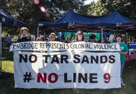 Banner drop at Enbridge Booth Toronto