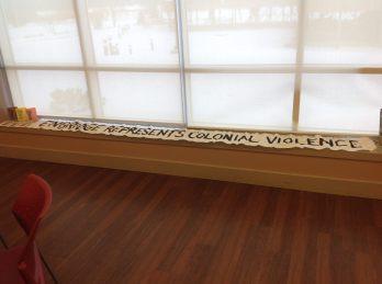 Banner drop at Enbridge Meeting